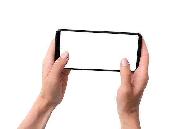 Mock-up eines schwarzen smartphones in den händen für ihr design