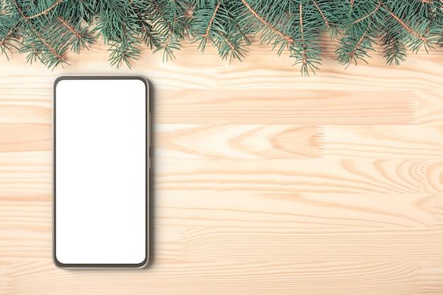 Mock-up-handy auf holztisch im hintergrund während der weihnachtsferien