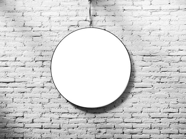 Mock-up runder leuchtkasten. weißer leerer kreisraumrahmen auf weißem backsteinmauerhintergrund.