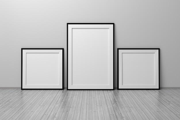 Mockup-vorlage mit drei quadratischen rahmen und a4-format, die in einem raum auf dem boden stehen. 3d-darstellung.