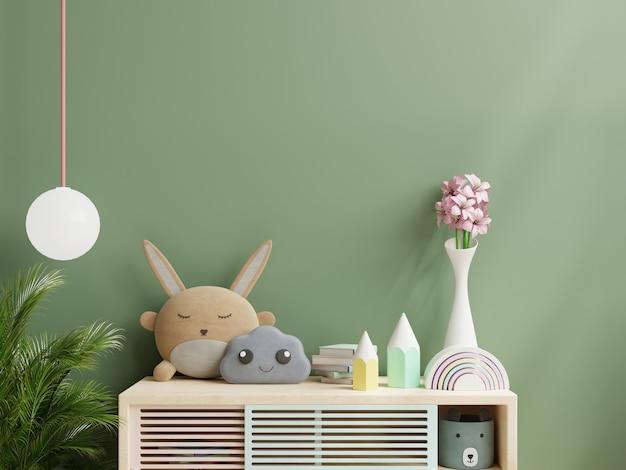 Mockup-wand im kinderzimmer mit schrank in grünem wandhintergrund. 3d-rendering