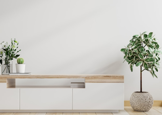 Mockup weiße wand mit zierpflanzen und dekorationsartikel auf dem schrank, 3d-rendering