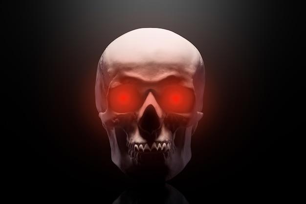 Modell des menschlichen schädels mit roten augen auf schwarzem hintergrund isoliert