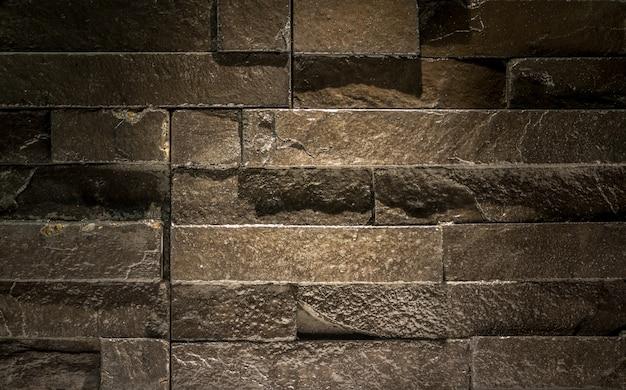 Moderne backsteinmauer - muster der schwarzen schieferwandbeschaffenheit und -hintergrundes
