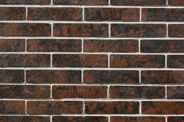 Moderne braune backsteinmauerbeschaffenheit im freien für hintergrund