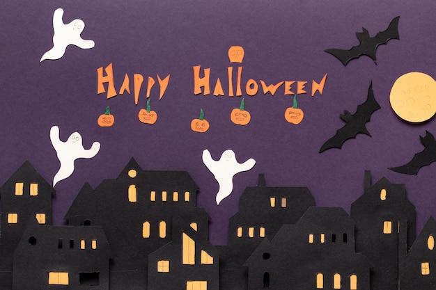 Moderne geschenkkarte mit halloween auf dunklem hintergrund. helloween im scherenschnitt-stil auf dunklem hintergrund. fröhliches halloween.