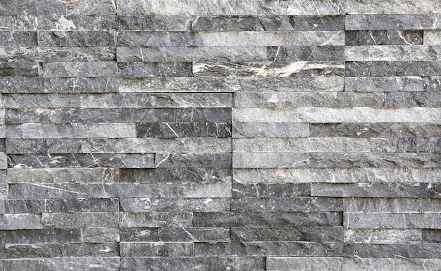 Moderne graue steinfliesenbeschaffenheits-backsteinmauer