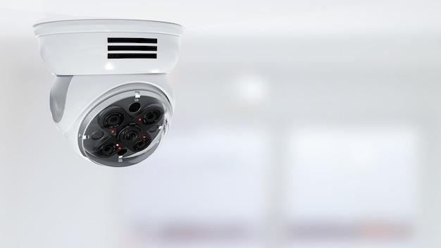 Moderne überwachungskamera auf unscharfem büro