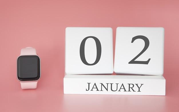 Moderne uhr mit würfelkalender und datum 02. januar auf rosa hintergrund. konzept winterzeit urlaub.