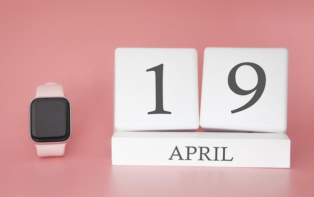 Moderne uhr mit würfelkalender und datum 19. april auf rosa hintergrund. konzept frühlingszeit urlaub.