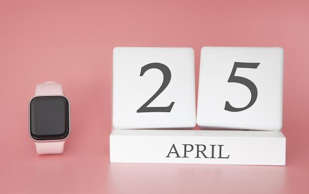 Moderne uhr mit würfelkalender und datum 25. april auf rosa hintergrund. konzept frühlingszeit urlaub.