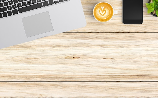 Moderner arbeitsplatz mit kaffeetasse, notizbuch, tablette oder smartphone und laptop auf holz