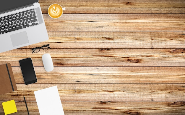 Moderner arbeitsplatz mit kaffeetasse, papier, notizbuch, tablette oder smartphone und laptop auf holz