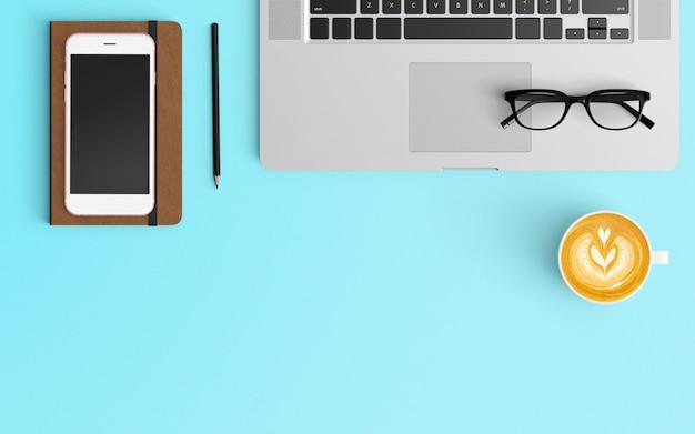 Moderner arbeitsplatz mit kaffeetasse, smartphone, notizbuch und laptop auf blauer farbe