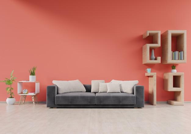 Moderner wohnzimmerinnenraum mit sofa und grünpflanzen, lampe, tabelle auf lebendem wandhintergrund der koralle 2019, wiedergabe 3d