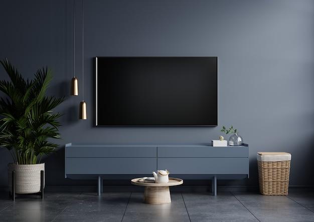 Modernes interieur des wohnzimmers mit fernseher auf dem schrank auf dunkelblauer wand