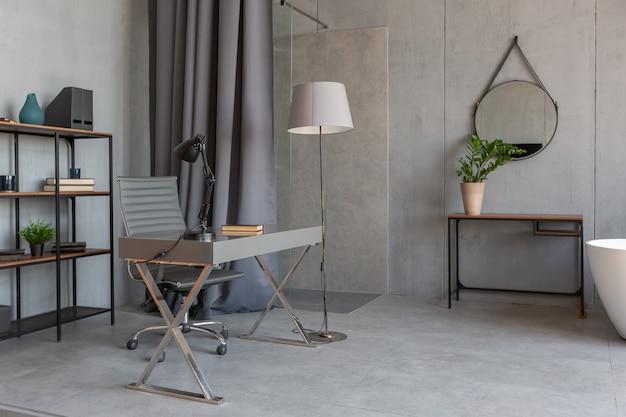 Modernes, minimalistisches, dunkelgraues studio-apartment im loft-stil