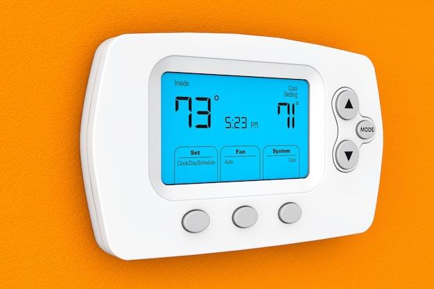 Modernes programmierthermostat an einer orangefarbenen wand