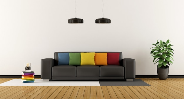 Modernes wohnzimmer mit buntem kissen auf schwarzem sofa