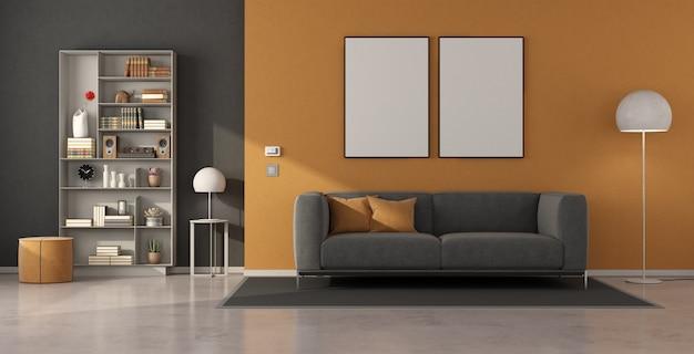 Modernes wohnzimmer mit grauem sofa und bücherregal