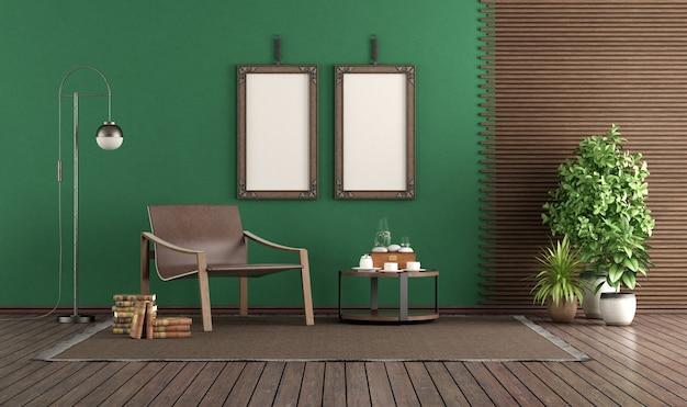 Modischer ledersessel in einem grünen wohnzimmer