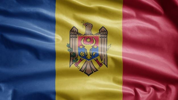 Moldauische flagge weht im wind. moldavia banner weht, weiche und glatte seide. stoff stoff textur fähnrich hintergrund. verwenden sie es für nationalfeiertage und länderanlässe