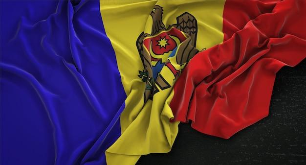 Moldawien-flagge geknickt auf dunklem hintergrund 3d render