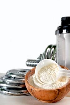 Molkeprotein geschmack vanille mit hantel