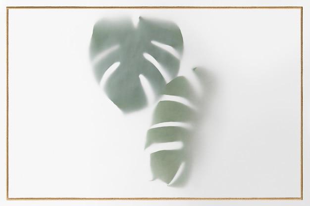 Monstera delicosa pflanze hinterlässt schatten mit goldenem rahmen