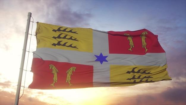 Montbéliard-flagge, frankreich, im wind-, himmels- und sonnenhintergrund wellenartig. 3d-rendering