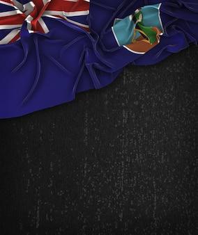 Montserrat-flagge vintage auf einem grunge-schwarz-tafel mit platz für text