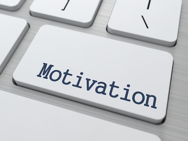 Motivation - taste der modernen weißen computertastatur.