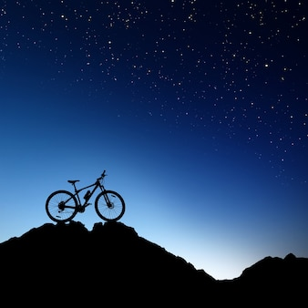 Mountainbike-silhouette über nachthimmel