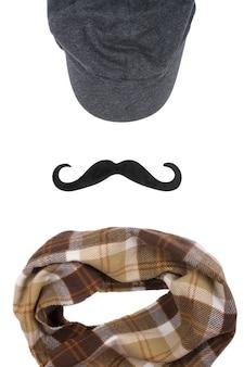 Mütze, schwarzer schnurrbart und karierter schal