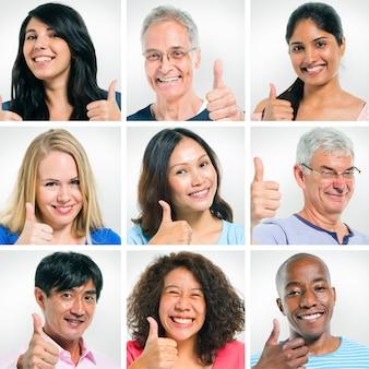 Multiethnische gruppe von personen, die ihre daumen zeigt