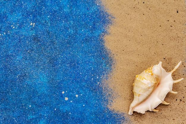 Muschel, sand und glitzer