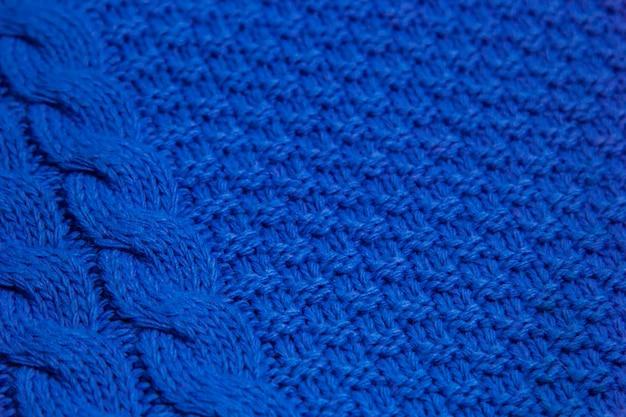 Muster der bunten gestrickten strickjackennahaufnahme. handgemachte merinowolle. strickmuster.