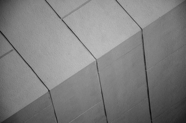 Muster der perspektive der form in dunklem licht-schwarz-weiß