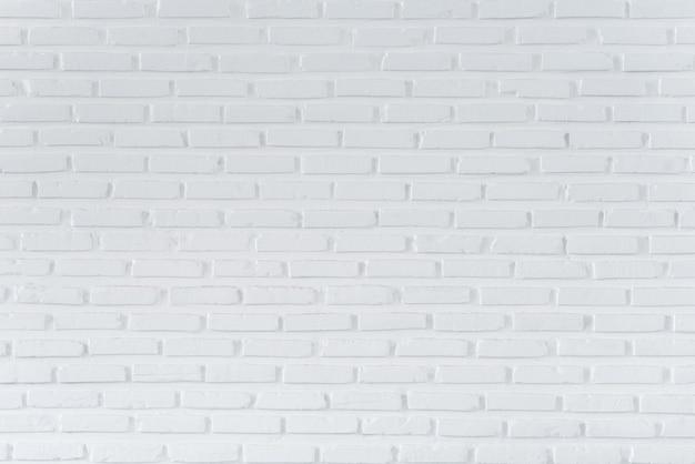 Muster der weißen backsteinmauer