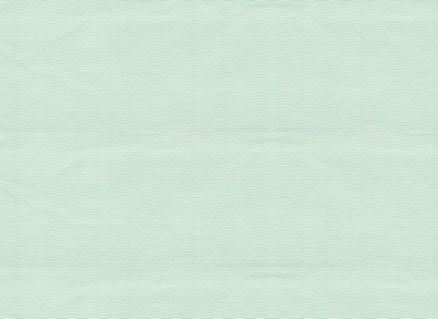 Muster gebogene linie auf grünem papier.