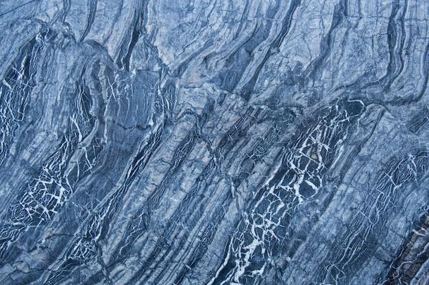 Muster und beschaffenheiten von natürlichen grauen und schwarzen marmorwänden für hintergrund- und fliesendesign.