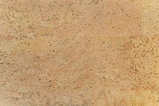 Muster von gelbbraunen korkplattenmöbeln für innenböden.