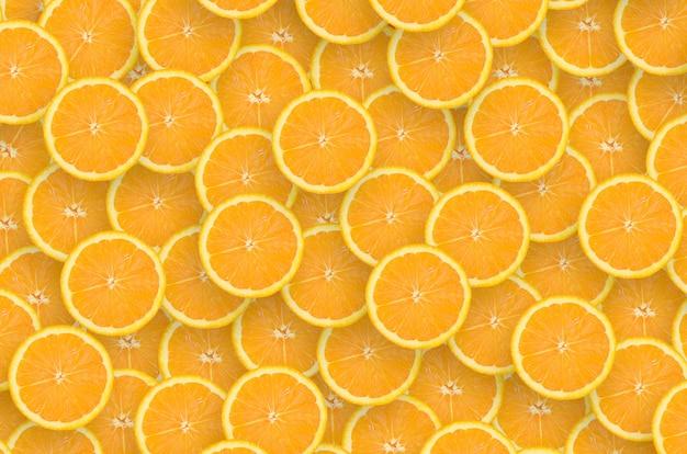 Muster von orange zitrusfruchtscheiben. zitrusfrüchte flach legen