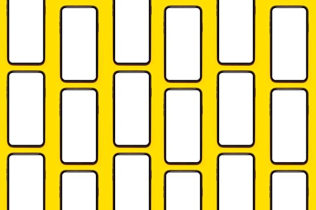 Muster von smartphones mit modell lokalisiert auf hintergrund der gelben farbe.