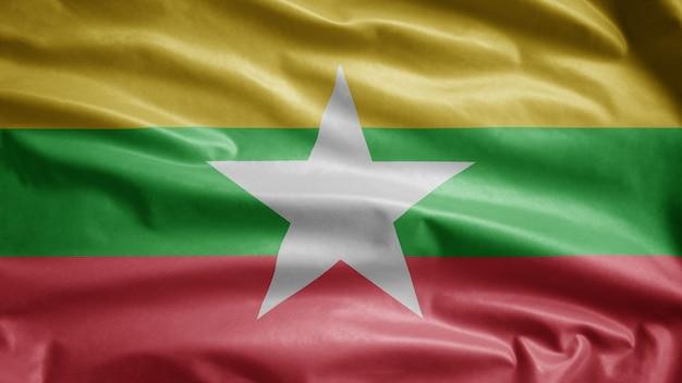 Myanmar fahnenschwingen im wind. nahaufnahme von burma banner bläst glatte seide. stoff textur fähnrich