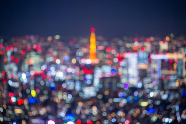 Nacht verschwommenes bokeh-licht-japan-stadtbürogebäude, abstrakter hintergrund