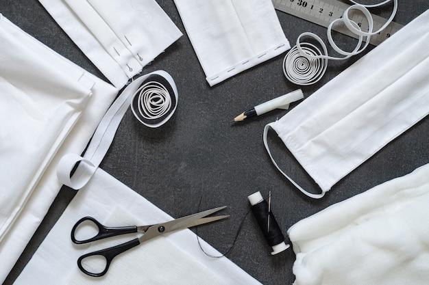 Nähen von antiviren-schutzmasken mit eigenen händen. werkzeuge, teile und fertige maske