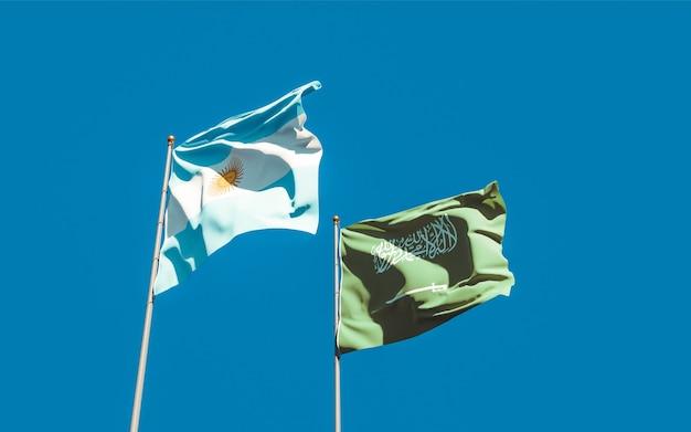 Nahaufnahme auf flaggen von saudi-arabien und argentinien