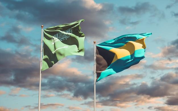 Nahaufnahme auf flaggen von saudi-arabien und bahamas