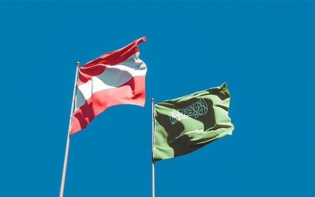 Nahaufnahme auf flaggen von saudi-arabien und österreich